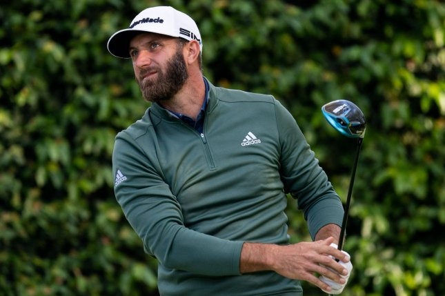 Dustin Johnson hits off of the second tee during a practice round for the 2021 Masters Tournament on Monday in Augusta, Ga. Photo by Kevin Dietsch/UPI