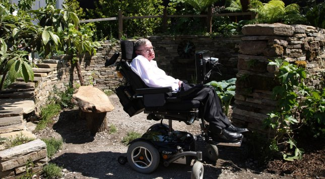 Astro physicist Professor Stephen Hawking sits in a garden inspired by his book a brief history of Time at the 2010 Chelsea Flower Show in London. The flower show is one of the hottest tickets in the London summer season. UPI/Hugo Philpott