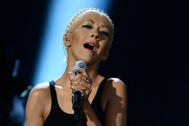 Singer Christina Aguilera performs at the 41st annual American Music Awards in 2013. File Photo by Jim Ruymen/UPI