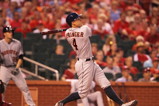 Houston Astros' George Springer swings hitting a two run home run in the eighth inning against the St. Louis Cardinals at Busch Stadium in St. Louis on June 15, 2016. Photo by Bill Greenblatt/UPI