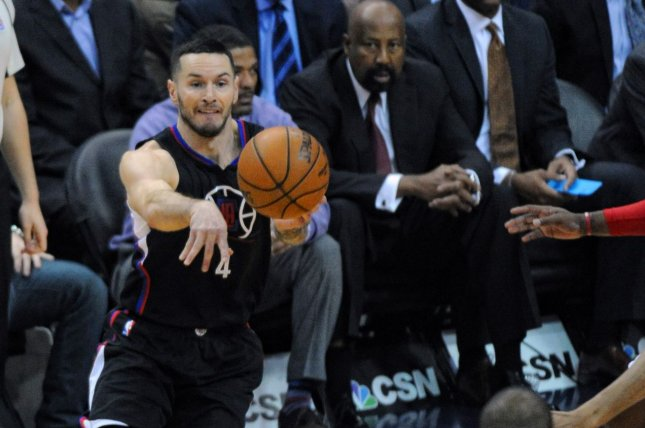 LA Clippers guard J.J. Redick (4) makes a pass against the Washington Wizards in the first half at the Verizon Center in Washington, D.C. on December 18, 2016. Photo by Mark Goldman/UPI