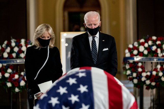 Democratic presidential nominee and former Vice President Joe Biden and his wife Dr. Jill Biden view the casket of Supreme Court Justice Ruth Bader Ginsburg on Friday as she lies in state at the U.S. Capitol in Washington, D.C. Photo by Erin Schaff/UPI/Pool