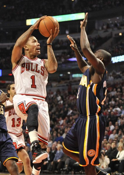 Chicago Bulls guard Derrick Rose (L) shoots over Indiana Pacers guard Darren Collison at the United Center in Chicago, Jan. 25, 2012. UPI/Brian Kersey