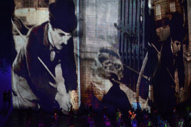 Images of Charlie Chaplin are shown July 27, 2012, during a Tribute to Film and Music in the opening ceremony of the London Summer Olympics. On Feb. 5, 1919, Chaplin and fellow stars Douglas Fairbanks and Mary Pickford and director D.W. Griffith formed the United Artists film company. UPI/Pat Benic/File