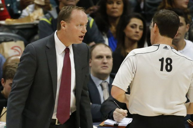 Atlanta Hawks head coach Mike Budenholzer (L) argues a call with referee Matt Boland during the first half of their NBA game against the Indiana Pacers at Philips Arena in Atlanta, January 21, 2015. Photo by David Tulis/UPI