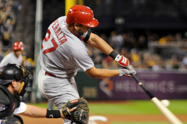 St. Louis Cardinals Jhonny Peralta (27) hits a two RBI single in the eighth inning of their 11-1 win over the Pittsburgh Pirates, that clinched the National League Central Division championship in game two of a doubleheader at PNC Park in Pittsburgh on September 30, 2015. Photo by Archie Carpenter/UPI