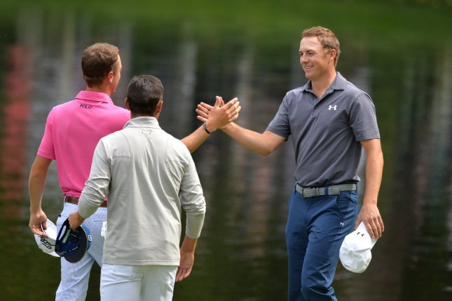 Jordan Spieth shakes hands with Justin Thomas during the Par Three Contest at the 2016 Masters Tournament at Augusta National in Augusta, Georgia on April 6, 2016. Photo by Kevin Dietsch