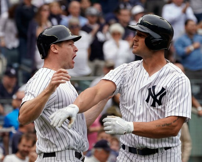 New York Yankees designated hitter Matt Holliday celebrates with runner Chase Headley after hitting a three-run home run off Boston Red Sox pitcher Drew Pomeranz during their game at Yankee Stadium on Saturday. Photo by Ray Stubblebine/UPI