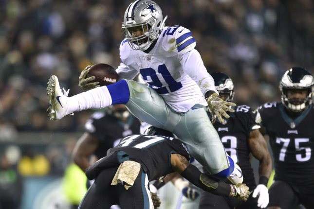 Dallas Cowboys running back Ezekiel Elliott (21) hurdles Philadelphia  Eagles defensive back Tre Sullivan (37) during an NFL football game on  Sunday at ... f3cf43e759b1