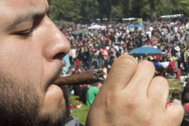A participant lights a blunt at the first sponsered 420 event in Golden Gate Park in San Francisco on April 20, 2017.  File Photo by Terry Schmitt/UPI