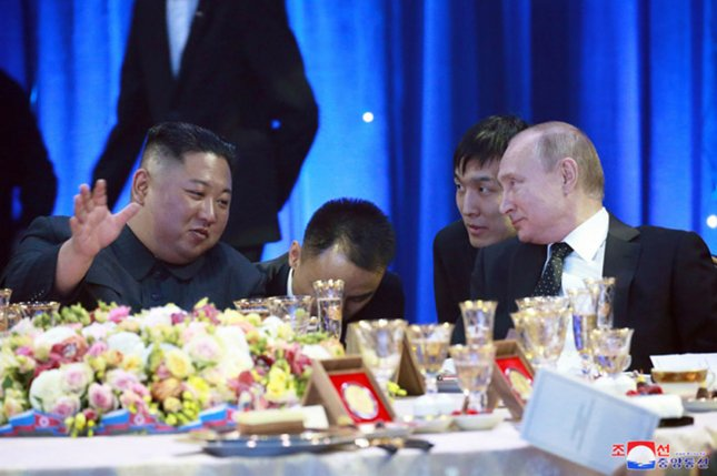 North Korean leader Kim Jong Un (L) meets with Russian President Vladimir Putin in April. Russia could be going around sanctions that apply to North Korean laborers, according to the U.S. Congressional Research Service. File Photo by KCNA/UPI