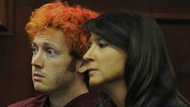 Accused movie theater shooter James Holmes (left) makes his first court appearance at the Arapahoe County Courthouse with his public defender Tamara Brady on July 23, 2012 in Centennial, Colorado. UPI/RJ Sangosti/Pool