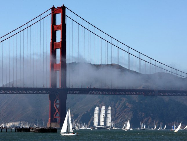 The yacht Maltese Falcon sails under the Golden Gate Bridge into San Francisco Bay under full sail surrounded by an armada of boats on September 27, 2008. The 289 foot high tech sailboat was built in Turkey by Silicon Valley venture capitalist Tom Perkins and was for sale earlier this year for $169 million. (UPI Photo/Terry Schmitt)