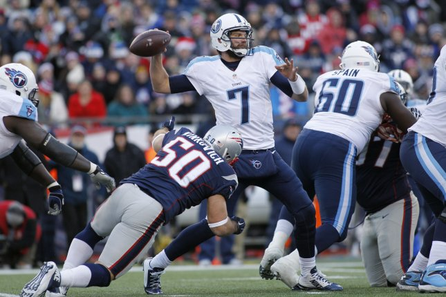 Former Tennessee Titans quarterback Zach Mettenberger (7) throws a pass while under pressure from New England Patriots defensive end Rob Ninkovich (50) in the third quarter at Gillette Stadium in Foxborough, Massachusetts on December 20, 2015. The Patriots defeated the Titans 33-16. Photo by Matthew Healey/ UPI