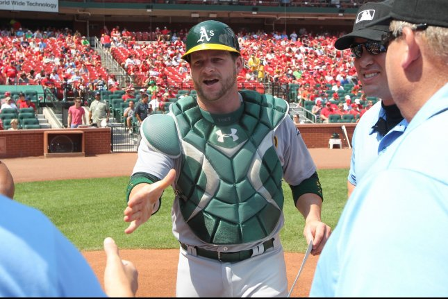 Oakland Athletics catcher Stephen Vogt delivers the lineup card to the umpires in his catching gear before a game against the St. Louis Cardinals at Busch Stadium in St. Louis on August 28, 2016. Photo by Bill Greenblatt/UPI