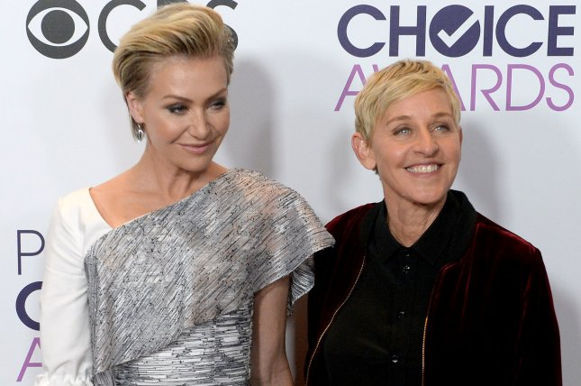 Ellen Degeneres and actress Portia De Rossi appear backstage during the 43rd annual People's Choice Awards on January 18. DeGeneres explained on Ellen Tuesday how she dislocated her finger when she tripped outside her home. File Photo by Jim Ruymen/UPI