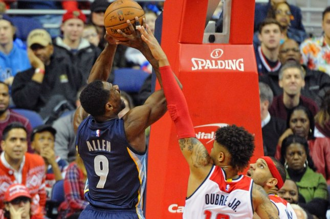 Memphis Grizzlies forward Tony Allen (9) is fouled by Washington Wizards forward Kelly Oubre Jr. (12). File photo by Mark Goldman/UPI