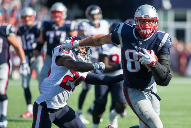 New England Patriots tight end Rob Gronkowski (87) sheds a tackle by Houston Texans safety Andre Hal (29) on a reception in the third quarter at Gillette Stadium in Foxborough, Massachusetts on September 24, 2017. File photo by Matthew Healey/UPI
