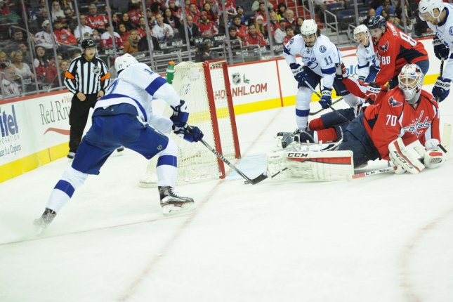 Washington Capitals goalie Braden Holtby (70) gives up a goal to Tampa Bay Lightning center Alex Killorn (17). File photo by Mark Goldman/UPI