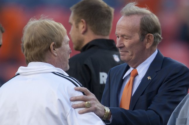 Denver Broncos owner Pat Bowlen (R) greets Oakland Raiders owner Mark Davis at midfield on September 23, 2013 at Sports Authority Field at Mile High in Denver. File photo by Gary C. Caskey/UPI