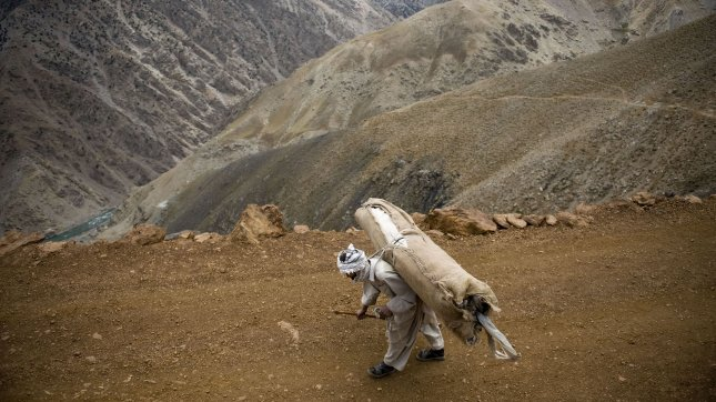 An Afghan man carries voting material to a polling location unreachable by vehicle, for Afghanistan's 2010 parliamentary elections. UPI/Hossein Fatemi