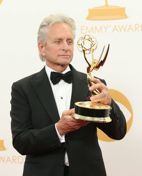 Actor Michael Douglas holds the award he won for Outstanding Lead Actor in a Miniseries or a Movie - Behind The Candelabra at the 65th Primetime Emmy Awards at Nokia Theatre in Los Angeles on September 22, 2013. UPI/Danny Moloshok