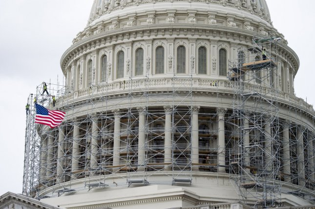 The dome of the U.S. Capitol is wrapped in scaffolding for a multi-year renovation. UPI/Kevin Dietsch