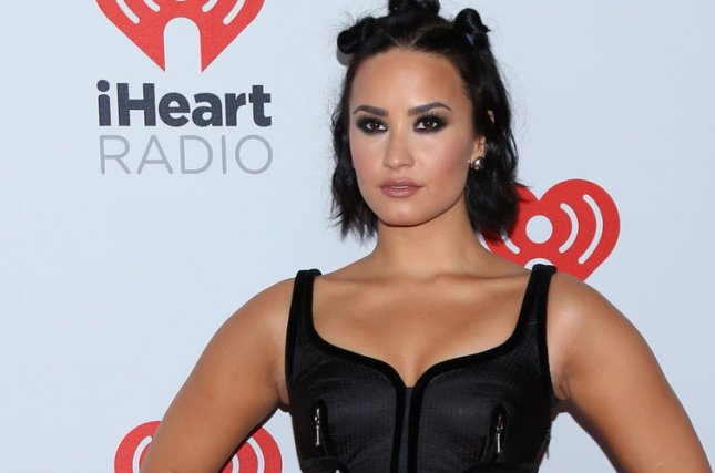 Demi Lovato arrives in the press room for the iHeartRadio Music Festival at the MGM Grand Hotel in Las Vegas, Nev., on Sept. 18, 2015. The singer is in Washington, D.C. this week to speak to lawmakers about mental health reform and easier access to healthcare on behalf of the Be Vocal: Speak Up for Mental Health campaign. Photo by James Atoa/UPI