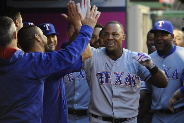 Texas Rangers' Adrian Beltre is congratulated by teammates. Photo by Lori Shepler/UPI.