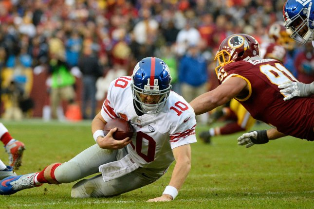 New York Giants quarterback Eli Manning (10) is sacked by Washington Redskins linebacker Ryan Kerrigan (91) for a 10-yard loss during the second half of their football game at FedEx Field in Landover, Maryland, November 29, 2015. Photo by David Tulis/UPI