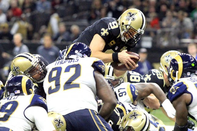 New Orleans Saints quarterback Drew Brees (9) scores against the Los Angeles Rams in the second quarter at the Mercedes-Benz Superdome in New Orleans November 27, 2016. Photo by AJ Sisco/UPI