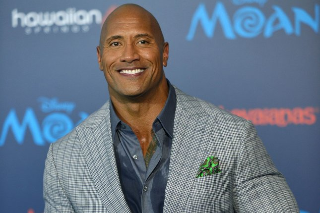 Dwayne Johnson arrives at the world premiere of Moana on November 14. Johnson detailed his excitement to portray DC Comics character Black Adam calling him the most intriguing superhero. File Photo by Christine Chew/UPI
