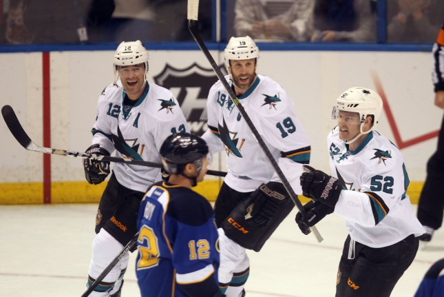 San Jose Sharks' Patrick Marleau (12) and Joe Thornton (19) skate in to celebrate a goal by Matt Irwin (52) against the St. Louis Blues in the first period at the Scottrade Center in St. Louis on December 17, 2013. UPI/Bill Greenblatt