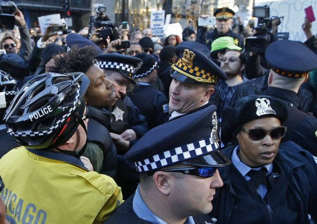 Chicago police officers arrest a protester outside of City Hall in Chicago on December 9, 2015. A new study found that increased cortisol levels in police officers may be linked to an increased risk of cardiovascular disease. Photo by Kamil Krzaczynski/UPI
