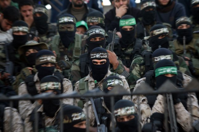 Members of the Ezzedine al-Qassam Brigades, the military wing of the Palestinian Islamist movement Hamas, take part in a rally ahead of the 29th anniversary of Hamas of the founding of the movement in Khan Younis in the southern Gaza, December 11, 2016. File Photo by Ismael Mohamad/UPI