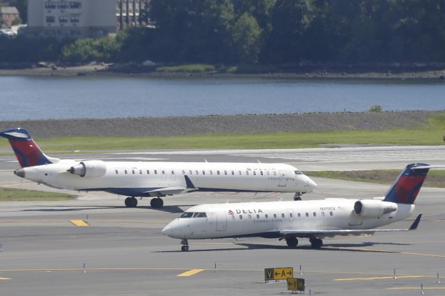 Two Delta Airlines planes move on the runway at LaGuardia Airport in New York City. The airline has struggled to get back on track after mass cancelations earlier this week caused by powerful thunderstorms. File Photo by John Angelillo/UPI