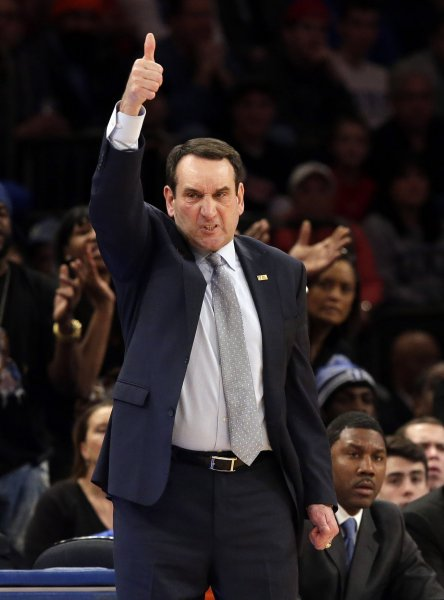 Coach Mike Krzyzewski and the Duke Blue Devils face the Louisville Cardinals on Wednesday. Photo by John Angelillo/UPI