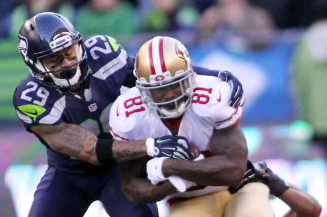 Seattle Seahawks free safety Earl Thomas (29) and linebacker K.J. Wright tackle ex-San Francisco 49ers wide receiver Anquan Boldin (81) on November 22, 2015 at CenturyLink Field in Seattle, Washington. File photo by Jim Bryant/UPI