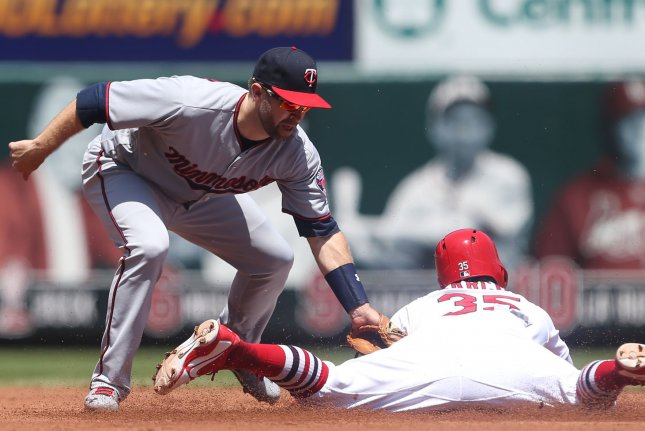 Minnesota Twins second baseman Brian Dozier makes the tag on St. Louis Cardinals' Greg Garcia as he tries to steal second base in the second inning on May 8 at Busch Stadium in St. Louis. Photo by Bill Greenblatt/UPI