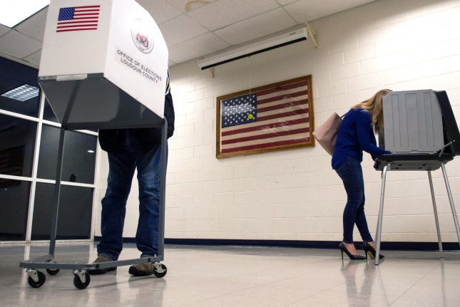 Voters fill out ballots during the midterm elections on November 6, 2018. Photo by Kevin Dietsch/UPI