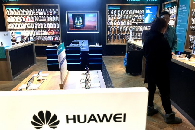 Chinese sales persons wait for customers at an Huawei showroom in Beijing on January 30, 2019. A company executive revealed on Thursday that Huawei has developed its own operating system, File Photo by Stephen Shaver/UPI