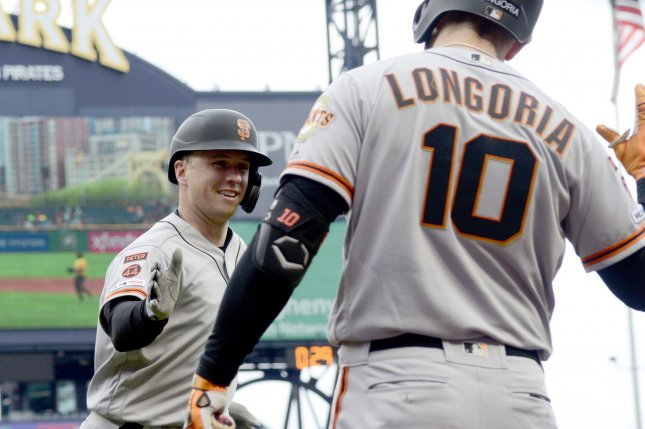 San Francisco Giants catcher Buster Posey (L) hit his first home run since June 19 in a win against the Pittsburgh Pirates on Sunday in Pittsburgh. Photo by Archie Carpenter/UPI