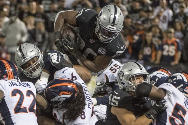 Oakland Raiders running back Josh Jacobs (28) had 85 yards and two touchdowns on 23 carries during a win against the Denver Broncos Monday in Oakland. Photo by Terry Schmitt/UPI