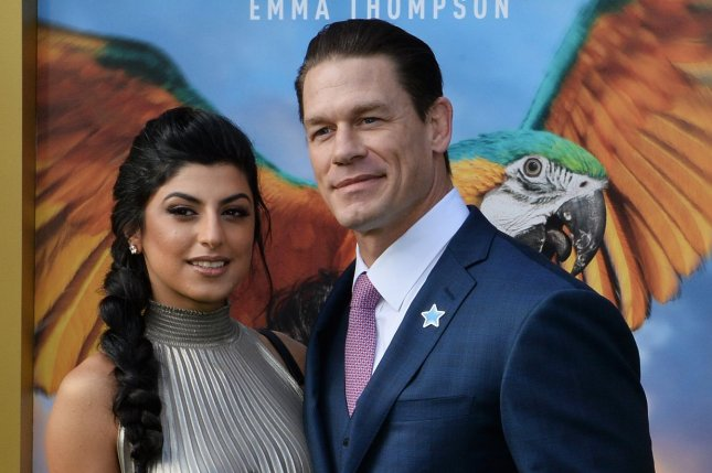 WWE star John Cena and his girlfriend Shay Shariatzadeh attend the premiere of Dolittle. WWE has announced that WrestleMania 36 will still be taking place but will not feature a live audience due to COVID-19. File Photo by Jim Ruymen/UPI.