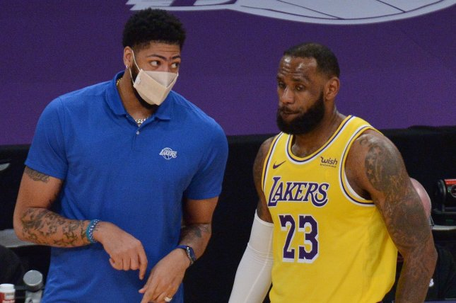 Los Angeles Lakers forward LeBron James (R) scored 31 points and Anthony Davis (L) missed his fourth-consecutive game as the reigning champions lost a close contest to the Washington Wizards on Monday in Los Angeles. File Photo by Jim Ruymen/UPI