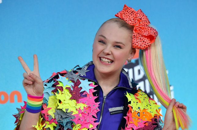 JoJo Siwa explained how she and girlfriend Kylie Prew celebrate the anniversaries of four relationship milestones. File Photo by Christine Chew/UPI