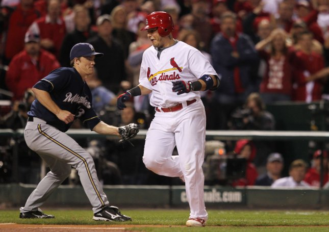 St. Louis Cardinals Yadier Molina sneaks past Milwaukee Brewers Zack Greinke to score on a two RBI hit by Jaime Garcia in the second inning of Game 5 in the NLCS at Busch Stadium in St. Louis, Oct. 14, 2011. The Cardinals won the game 7-1 and lead the series 3-2. UPI/Bill Greenblatt