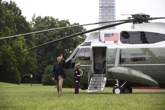 President Obama waves as he arrives on the South Lawn of the White House upon returning from a summit in southern California with Chinese President Xi Jinping in Washington, DC on June 9, 2013. UPI/Jim Lo Scalzo/Pool