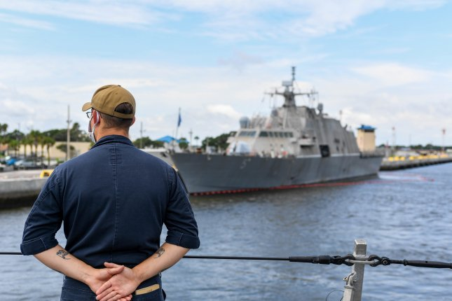 Information Specialist 1st Class Matthew Stephenson mans the lines as the Freedom-variant littoral combat ship USS Sioux City gets underway from Naval Station Mayport. Photo by Mass Communication Specialist Seaman Juel Foster/U.S. Navy