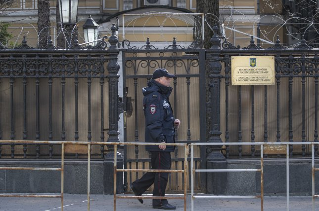 Russian policeman walks near the fence of the Ukrainian embassy Saturday in Moscow, Russia. Photo by Sergei Ilnitsky/EPA-EFE